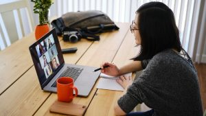 woman on video call with laptop